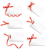 Set of card notes with red gift bows with ribbons — Cтоковый вектор