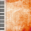 Grunge paper background with piano keys — Stock Photo