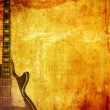 Guitar on grunge background - Stock Photo