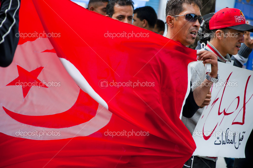 Protest of Tunisian in Bourguiba Street with the view of the cityscape — Stock Photo #10966779