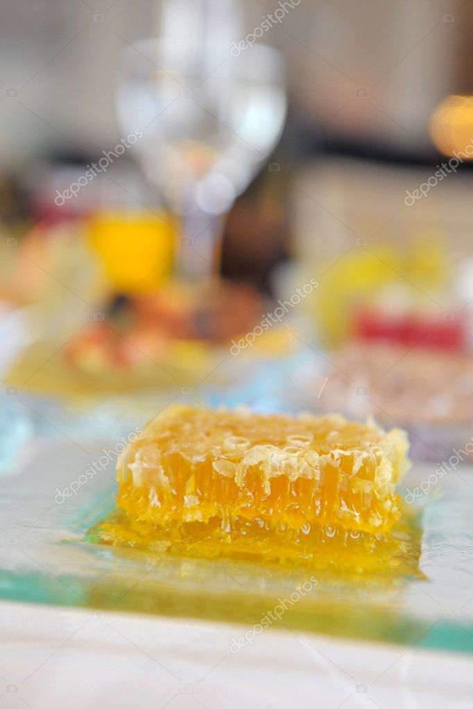 A piece of deliccious honeycomb on a table  Foto Stock #11388311