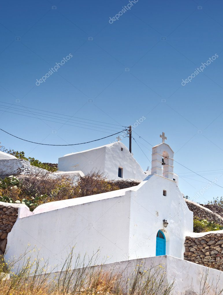 Mykonos island with wihtewash little houses, tiny churches and beautiful old windmills in summertime  Stock Photo #11905715