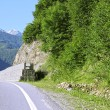 Stock Photo: Road leading between the mountains. Caucasus travel