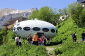 People around UFO that landing between caucasus mountains — 图库照片