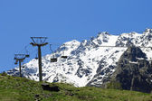 Empty cableway and caucasus mountains background — Stok fotoğraf