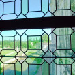 Old green medieval glass of window — Stock Photo