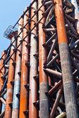 Rust pipe in olds bridge — Stock Photo