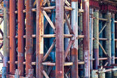Metal rust pipes in old bridge — 图库照片