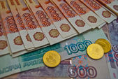 Coins and different banknotes — Stock Photo