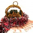 Cristmas gold basket with tinsel - Stock Photo