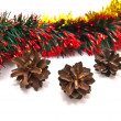 Pinecones and tinsel fragment — Stock Photo