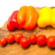 Cherry tomatoes and peppers on white — Stock Photo