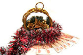 Cristmas gold basket with tinsel — Stock Photo
