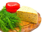 Cheese with paprika and herbs on cutting board — Stockfoto
