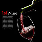 Red wine poured into glass — 图库照片