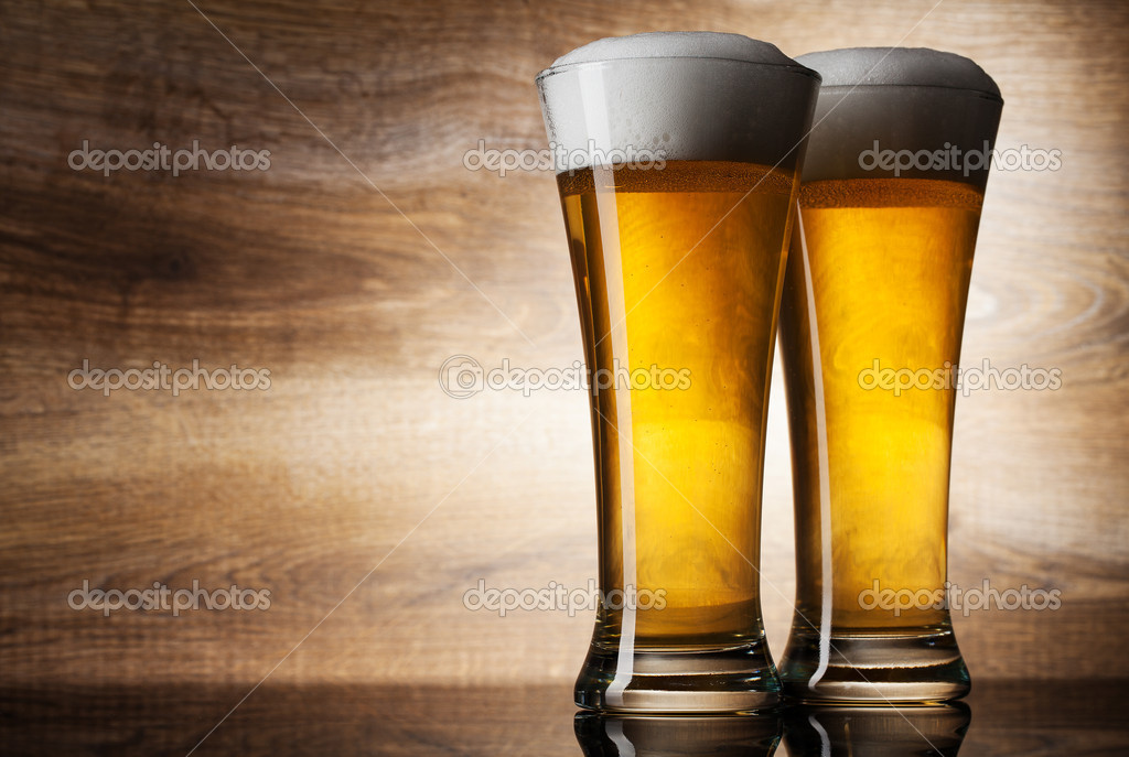 Two glass beer on wood background with copyspace — Stock Photo #11372864