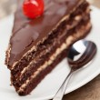 Slice of chocolate cake with cherry - Stock Photo