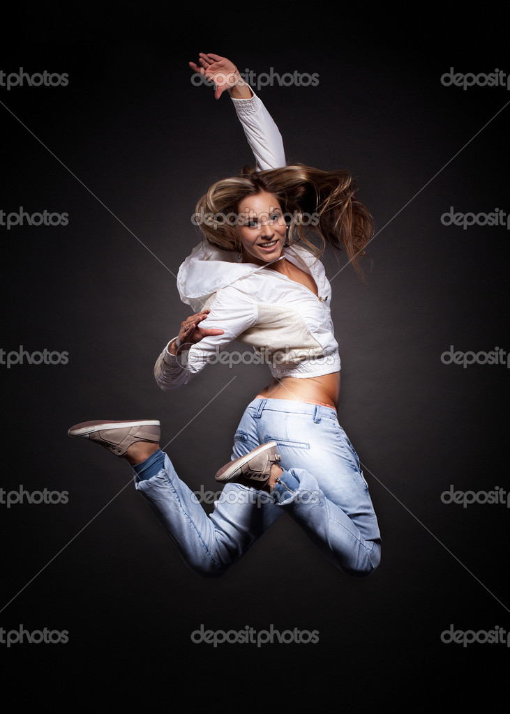 Attractive young woman dancing, hair flying — Stock Photo #11766126