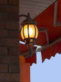 Cafe lamp with canvas awning — Stock Photo