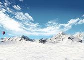 Paisagem de montanha com neve e balão de ar quente voando no s — Foto Stock
