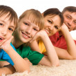 Cute family lying on carpet — Stock Photo #10934181