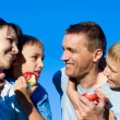 Family and apples — Stock Photo