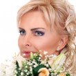 Cute bride with flowers — Stock Photo
