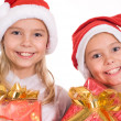 Two girls with gift — Stock Photo