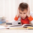 Young boy with books — Stock Photo