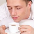 Cute guy with tea — Stock Photo #10935084