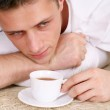 Cute guy with tea — Stock Photo #10935087