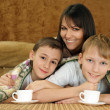 A beautiful Caucasian mother with two adorable brothers — Stock Photo #10935266