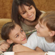 A beautiful Caucasian nice mother with two adorable brothers — Stock Photo #10935267