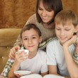 A beautiful Caucasian good mother with two adorable brothers — Stock Photo #10935268