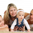 Stock Photo: Happines family of four lying