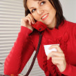 Beautiful Caucasian woman with a phone  and a cup — Foto Stock