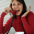 Beautiful Caucasian nice woman with a phone  and a cup — Stock Photo
