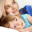 Mother and daughter lying — Stock Photo