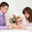 Joy Caucasian guy and his girlfriend are sitting at a table — Foto Stock