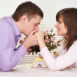 Nice Caucasian guy and his girlfriend are sitting at a table — Stockfoto