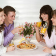 Pleasant Caucasian group of four with pizza and juice sit — Stock Photo #10936284