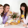 Good Caucasian group of four with pizza and juice sitting — Stock Photo #10936285