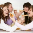 Bliss Caucasian group of four with pizza and juice sittin — Stock Photo