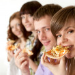 Joy funny Caucasian campaign of four eating pizza — Stock Photo #10936299