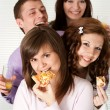 Stock Photo: Happy funny campaign of four eating pizza