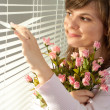 Stock Photo: Beautiful bliss Caucasiwomstanding with flowers