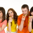 Happy Caucasibrilliant campaign of four eating pizza — Stok Fotoğraf #10936328