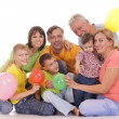 Family with baloons — Stock Photo