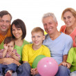 Happy family at sofa — Stock Photo