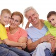 Grandchildren with grandparents — Stock Photo